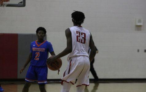 Photo Gallery: Varsity Men's Basketball Wins First Region Game