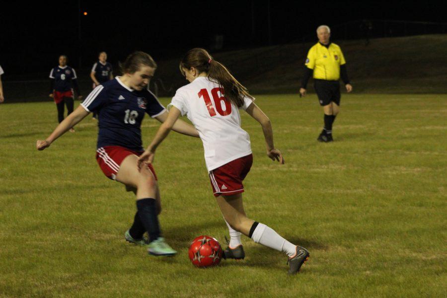 Senior+Teagan+Boucher+has+great+footwork+that+helps+her+get+around+the+opponent.+