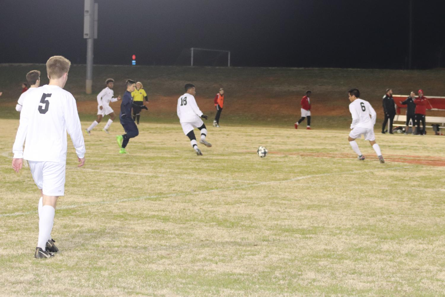 Senior Jaden Rawlenson passes the ball back to Senior Diego Rodriguez so he is able to send the ball up the field.