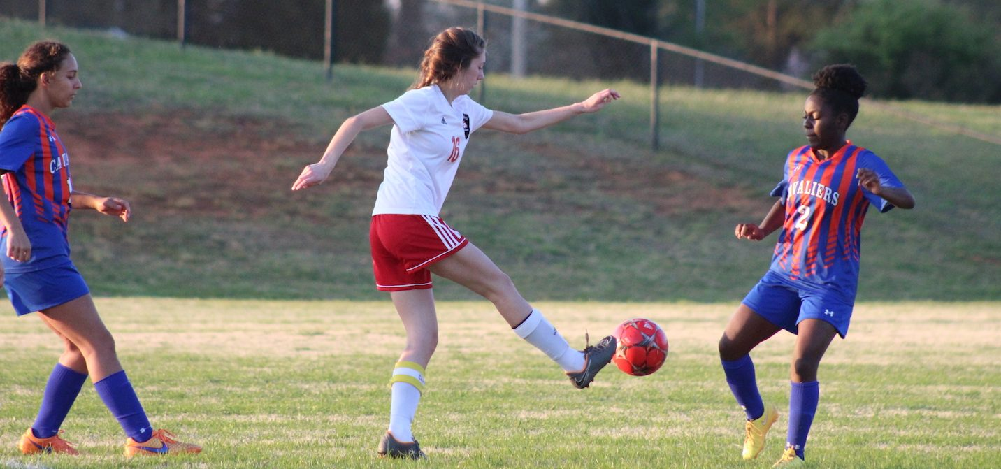 Senior Teagan Boucher puts her foot under the ball  to put it in the air.