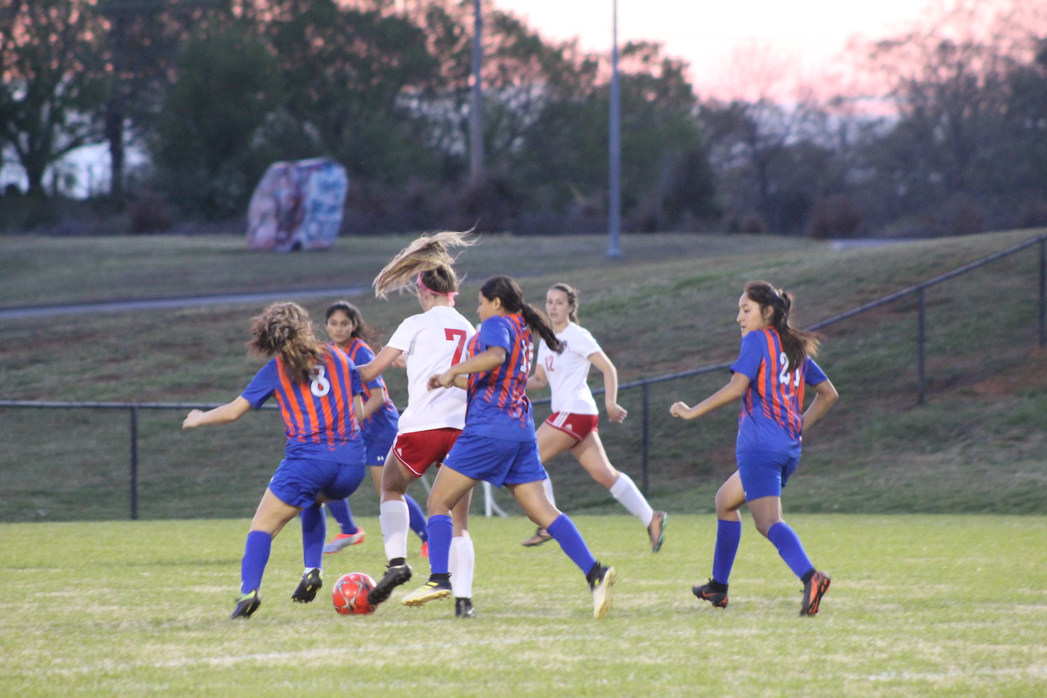 Sophomore Zoe Kennedy maneuvers through the Richland Northeast defensive line for a shot on goal.