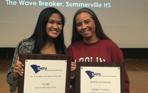SCSPA scholarship recipient Kinsley Thurston celebrates her award with S.C. 2018 Journalist of the Year Vy Mai. Both stallions hold their large plaques, presented Monday at the University of South Carolina's Russell House.