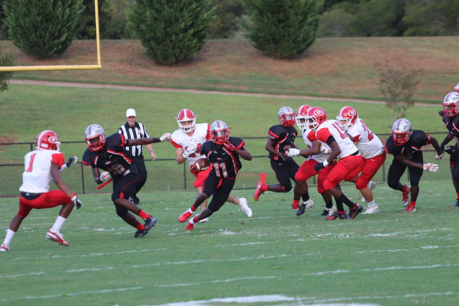 WR Travis Foster runs the ball towards the endzone.